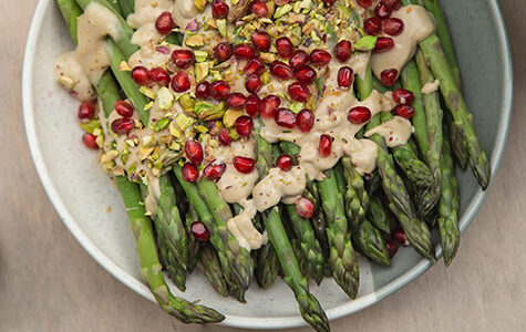 Cooked,Asparagus,With,Tahini,Sauce,,Pistachios,And,Pomegranate,,Top,View.