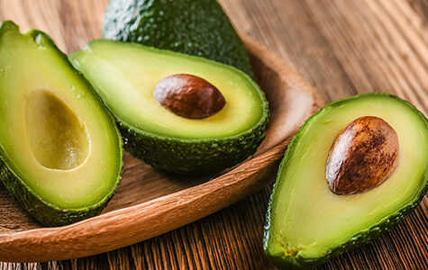 Avocado,On,Old,Wooden,Table.halfs,On,Wooden,Bowl.,Fruits,Healthy